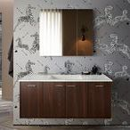 Big-Game Bathroom / If your instincts are telling you to go big with bathroom design, why not heed the call of the wild? Let boldly graphic walls and floors take the lead, balanced by simple shapes in the vanity and faucets.