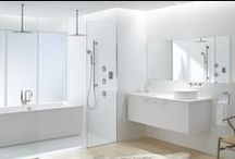 Pure White Bathroom / If calm and tranquility top your bathroom wish-list, consider opting for a white-on-white palette and sleek modern style. Smart storage and simple lines keep your physical space and your mind blissfully free of clutter, while brushed-nickel finishes and organic elements add welcome warmth. Tandem showers, a soaking tub, and a truly intelligent toilet round out the room for the ultimate in comfort, cleanliness and relaxation. / by Kohler Co.