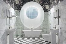 Dark Floral Bathroom / This bathroom pairs a duo of decidedly different bold patterns: a crisp geometric tile floor and a bountiful floral border that draws the eye upward. / by Kohler Co.