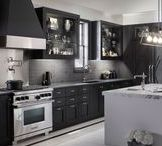 Gentleman's Black Kitchen / Designed for entertaining, this black and white kitchen features three separate sinks and function-rich Artifacts faucets.