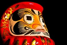 "JAPAN_Daruma 達磨 / Japanese Daruma dolls - The eyes of Daruma are often blank when sold. Its ""oversized symmetrical round blank white eyes"" as a means to keep track of goals or big tasks and motivate them to work to the finish. The recipient of the doll fills in one eye upon setting the goal, then the other upon fulfilling it. In this way, every time they see the one-eyed Daruma, they recall the goal. 達磨 / by M. Kawatou"
