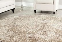 Rug / floor covering of thick woven material or animal skin, typically not extending over the entire floor