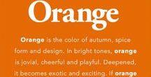 Orange / Orangey-orange, a little bit peachy, some coral, but no red.