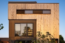 Lobster Boat Residence / Built on the foundation of an existing cottage, this modern house is restrained to a 24'x28' footprint. Using every available zoning allowance, a vertical house was created.  5 floor levels culminate in a roof deck with views of Seattle's Portage Bay.  The front of the building is clad in vertical cedar planks and houses the entry and stair that act as a buffer between interior life and a busy street in front.  Materials and details are purposefully honest and hard working.