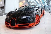 Orange and Black rides / A collection of hot wheels: Cars with orange and black paint jobs.