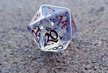 Dice - we all love them! / A collection of weird dice, rpg, four sided, six sided, eight sided, ten sided , twelve sided, twenty sided.