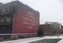 """Ed Ruscha's """"Honey, I Twisted Through More Damn Traffic Today"""" / Legendary artist Ed Ruscha's first public commission in NYC is """"Honey, I Twisted Through More Damn Traffic Today,"""" a High Line Art mural at West 22nd Street. The large-scale work is on view through May 2015."""