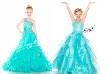 Sugar Girl's Pageant Dresses / Girl's pageant dresses from Sugar by Mac Duggal are now in-stock at So Sweet Boutique! This line of dresses is stunning! The bright colors and intricate bead work in this collection will look gorgeous on stage for pageants! / by sosweetboutique.com