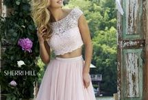 Pretty In Pink / Pink Dresses - A great pink dress will leaving you feeling sexy and cute at the same time. See one you love? Come visit us in Orlando to come see hundreds of incredible styles in person.