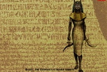 Bastet / Bast or Bastet is an ancient Egyptian goddess; the daughter of the sun god Ra. She is the protectress of women, children, and domestic cats. She was the goddess of sunrise, music, dance, and pleasure as well as family, fertility, and birth. Her feast day is October 31.