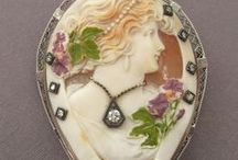 Cameo Appearance  (Shared Board) / A gem or shell carved in relief, especially one in which the raised design and the background consist of layers of contrasting colors. NO SPAM!! or ADS!!  Cameos are a classic piece of jewelry. I recently gave my daughter an antique cameo.