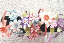 Hairbands / Satin covered headbands covered with felt flowers, leaves & sparkly gems or bead centres. NZ$10.00 each Cotton crochet covered bands with crochet flowers & button centres. NZ$18.00 each.  https://www.facebook.com/0narrival