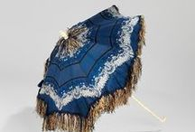 Victorian Parasols and Historic Period Parasols / Who can resist a woman strolling down the street in a beautiful Rococo, Edwardian, or Victorian dress holding a beautiful parasol. I would love to see some of these parasols. Wouldn't you?