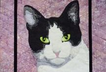 Cat Quilts / In 2010 we did a series on The Best of Cat Quilts and since then our collection has grown.  We'll be posting them all here! / by Quilt Inspiration