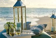 GENRE:  COASTAL / Water, white sand, beach wood, sea shells, pebbles, lanterns, stripes, linens