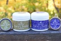"""Skin Salvy (""""savvy"""") Handcrafted All Natural Products Gifts / Why the buzz about Skin Salvy? How is it different from everything else out there? Great question! 1) We use only 2 (yes 2!) ingredients in our products: organic jojoba & USA local beeswax; essential oils are optional for scent; Dead Sea salt used in our 2-in-1 scrub. 2) No oils so Skin Salvy won't get rancid and stinky; no animal oils, no chemicals. Tested only on humans! Made in the USA. Family owned and operated."""