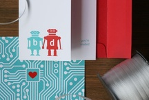 """Bianca + Dylan / It seems there are lots chic geeks out there! Bianca + Dylan contacted us for their own custom twist to our robot design for their wedding invitation and we were happy to help. Based in Brooklyn, NY, they were looking for a fun invitation that guests would say, """"that's so Bianca and Dylan"""" when they opened it up. With the bright colours, playful robots and cute wording, it certainly matched the mood of the wedding that would be held in the artistic enclave known as DUMBO."""