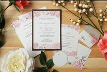 Maria + Juan / It's all in the details for Maria + Juan's invites. For their destination wedding, we created modern floral invites and day of pieces with luxurious ribbon, embossed monograms and shimmer paper in both English and Spanish.