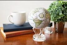 Globes / A unique collection of Gemstone globes and globes that move by solar power.