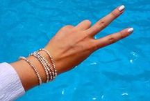 Peace, Love, and Pearls / Pearl jewellery, gold chains, silver bracelets.