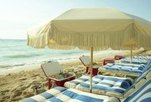 Beach Accessories / Beach bags, blankets, umbrellas, baskets, and cabanas for lounging on white sand beaches.