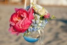 "Beach Weddings / Heading 'Down the Shore"" to tie the know and celebrate with a seaside reception. Beach-inspired wedding flowers and decor."