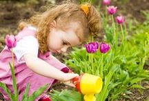 Kiddie Gardening / Show a child how to plant a garden and watch as they bloom!