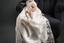 Penelope Collection / Incredibly detailed and truly a work of art. The undergown is 100% silk dupioni in ivory. The lace overlay on this christening gown is both stunning and special. Fully separable from the silk undergown, the lace overcoat is made of ivory & champagne embroidered netting in a rich floral design.