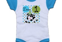 First Birthday / Baby's first birthday T-shirts, bodysuits, dresses, bibs,  first birthday invitations, first birthday postage stamps, and other first birthday gear to make baby's first birthday extra special.