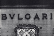 """BVLGARI / Bulgari is an Italian jeweler and luxury goods retailer. The trademark is usually written """"BVLGARI"""" in the classical Latin alphabet, and is derived from the surname of the company's Greek founder, Sotirio Voulgaris.  Sotirios Voulgaris began his career as a jeweller in his home village Paramythia, where his first store can still be seen. In 1877, he left for Corfu and then Naples. In 1881 he finally moved to Rome, where in 1884 he founded his company and opened his second shop in via Sistina."""