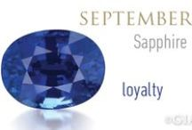 """SEPTEMBER BIRTHSTONE - SAPPHIRE / Besides blue sapphire and ruby, the corundum family also includes so-called """"fancy sapphires."""" They come in violet, green, yellow, orange, pink, purple, and intermediate hues. Some stones exhibit the phenomenon known as color change, most often going from blue in daylight or fluorescent lighting to purple under incandescent light. Sapphires can even be gray, black, or brown. Sapphire is the birthstone for September and the gem of the 5th and 45th anniversaries."""