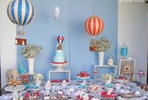 RODRIGO'S FIRST BIRTHDAY / Rodrigo celebrated his first birthday with hot air balloons and jungle animals. Blue, red and white were the colors chosen. A hot air balloon with a banner with the name Rodrigo carried jungle animals between the clouds. The tableware and decorative elements of Cosy Décor & Design gave the special touch to this table. Congratulations to Rodrigo!