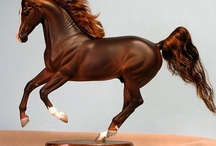Horse figurines / by Heidi Bright