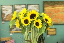 Signature Designs / Gaia is a flower and gift shop in Las Vegas' downtown Arts District. We specialize in sustainably grown flowers and desert accents arranged in pots and vases made by local artists, but can do any type of arrangement.