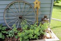 Hometalk Gardening Inspiration - Great Garden Backdrops / When designing an interesting garden or garden vignette, start with a great backdrop.  Some backdrops perfect for a rustic or junk garden include:  Wheels, Doors, Gates, Sheds, Fences, Bed Springs, Futon Parts, Ladders and even Walls. / by Carlene @ Organized Clutter