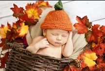 Portraits for Autumn Babies / Pumpkins, persimmons, pomegranates, apples. Reds, orange, and green. Cornucopia, harvest, baskets.  / by Mal