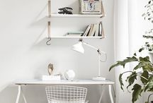 Workspace / Studios and home offices. Workspace interior design. Desks, lamps, office furniture and accessories. Wooden and concrete floors, notice boards, Eames chairs and fluffy sheepskin rugs.
