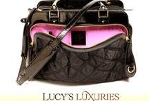 Lucy's Luxuries  / Upscale line of pet carriers and accessories.  Bags that look and function as both an everyday handbag and pet carrier.  Where fashion meets function!
