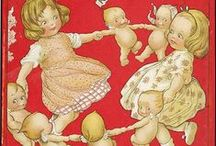 kewpies / Rose O'Neill's creation. Pudgy little darlings!