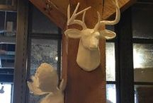Faux taxidermy / Animal heads and wall mounts in varied materials.
