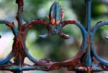 """Iron Works / Wrought iron is an iron alloy with a very low carbon (less than 0.08%) content in contrast to cast iron (2.1% to 4%), and has fibrous inclusions known as slag up to 2% by weight. It is a semi-fused mass of iron with slag inclusions which gives it a """"grain"""" resembling wood, that is visible when it is etched or bent to the point of failure. Wrought iron is tough, malleable, ductile, corrosion-resistant and easily welded."""