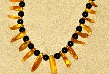 Art:  Amber and Jet / These stones are made from what was once alive.  Now it is petrified.  Amber is from Tree Resin and Jet is from Petrified Wood.  Together they are often considered a Witches Necklace.   / by Sandy Meadors