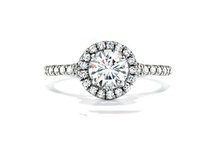 """I can see your Halo / The halo engagement ring style has quickly become one of the most popular ring settings at Reis-Nichols Jewelers. Check out these rings and other """"halo"""" style."""