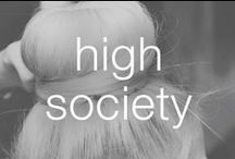 High Society / In a class of your own, you take chic and cheeky to new hair heights. The higher the hair, the closer to God.