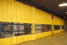 Warehouse Curtains / Divide space in a Warehouse with Industrial Curtain Walls. These retractable vinyl curtains used to separate spaces inside large facilities. Protect workers, equipment and inventory from dust, debris, odors, vapors and contaminates.