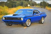 'Cuda / I am 'Cuda Crazy!  My fav car of all time....My '70 AAR Cuda was the fastest car I ever drove.... It stood up... took off... took names.. and nailed the competition... It freaked out everybody that a girl (namely me) could drive such a muscle car... but I did and I loved it.   A sad day when I had to sell it....Hope you enjoy looking at all the beautiful, sexy Cudas....  / by Holly Gribble Westfall