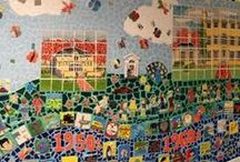 Gallery - Pen Ryn Mosaic Mural / AIR artists, Terri Herring and Amy Winston, completed the second side of a 25 foot hallway with a spectacular mosaic mural depicting the schools 70 year old history. The entire student body and some alumni participated in making the tiles. The mural features a timeline made up of significant events and cultural icons that the older students first researched and then sculpted out of clay.