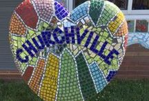 "Gallery - Sculpture Garden, Churchville Elementary, Southampton, PA / There is a tradition at Churchville Elementary that every student looks forward to. Each 6th grader gets to leave their ""mark"" at Churchville. This year the sculpture garden was created around the previous class' large flower mosaic that is located outside the art room facing the playground. Students worked with visiting AIR artist, Terri Herring."