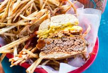 """Burgers and Fries / A hamburger (also called a beef burger, hamburger sandwich, burger or hamburg) is a sandwich consisting of one or more cooked patties of ground meat (usually beef) usually placed inside a sliced hamburger bun. Hamburgers are often served with lettuce, bacon, tomato, onion, pickles, cheese and condiments such as mustard, mayonnaise, ketchup and relish. The term """"burger"""" can also be applied to the meat patty on its own, especially in the UK where the term """"patty"""" is rarely used.  / by Progressive Research"""