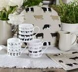 Cows Collection / Our Cows collection is a wonderful country design that showcases a selection of different breeds. The black and white Belted cow, the sandy coloured Highland cow, Jersey cow, Friesian Dairy cow and Aberdeen Angus breeds are all on a neutral fawn background. You'll find a range of kitchen fabrics, fine bone china and other decorative homewares, bags and accessories. Great gift ideas for country homes and interiors.